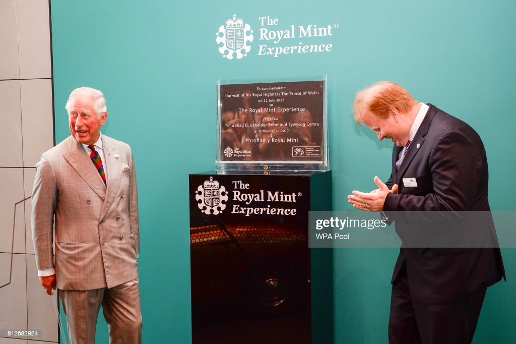 Prince Charles, The Prince of Wales unveils a plaque with Royal Mint CEO Adam Lawrence (right) during a tour of The Royal Mint's visitor centre on July 11, 2017 in Heol-Y-Sarn, Wales.
