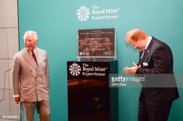 Prince Charles The Prince of Wales unveils a plaque with Royal Mint CEO Adam Lawrence during a tour of The Royal Mint's visitor centre on July 11...