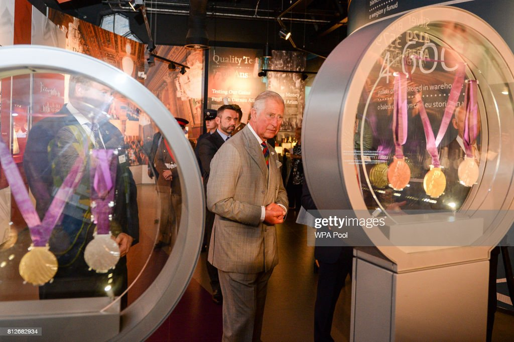 Prince Charles, The Prince of Wales views London 2012 medals in a glass case , during a tour of The Royal Mint's visitor centre on July 11, 2017 in Heol-Y-Sarn, Wales.