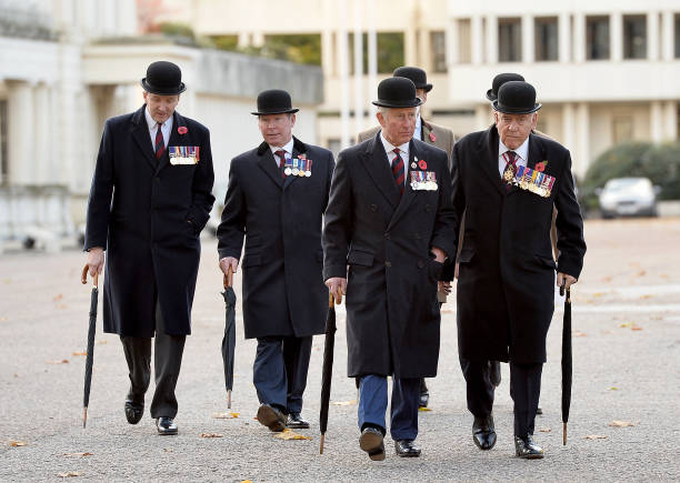 Prince Charles The Prince of Wales walks with Members of Welsh Guard as he attends the Welsh Guards' Remembrance Sunday service at Guards Chapel on...