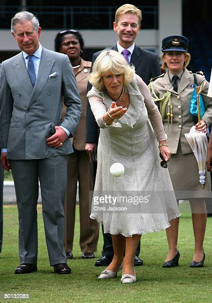 Prince Charles, The Prince of Wales watches Camilla, Duchess of Cornwall bowl at Queen's Cricket ground on the second day of a three day tour of...