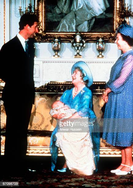 Prince Charles the Prince of Wales with Queen Elizabeth II and the Queen Mother at the christening of baby Prince William at Buckingham Palace London...