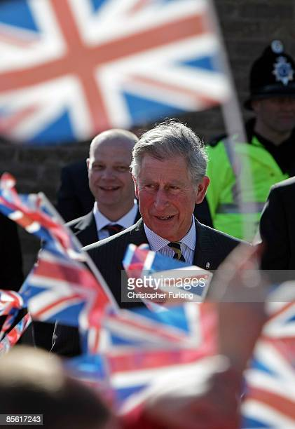 Prince Charles the Prince Wales greets flag waving school children during his visit to the Blacon Community Trust on March 26 2009 in Chester...