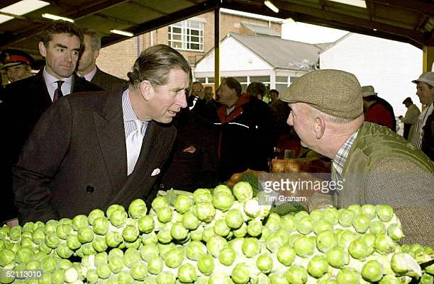 Prince Charles Visiting The Farmers Market In Melton Mowbray Leicestershirebehind Him Is His Police Bodyguard Tony Parker