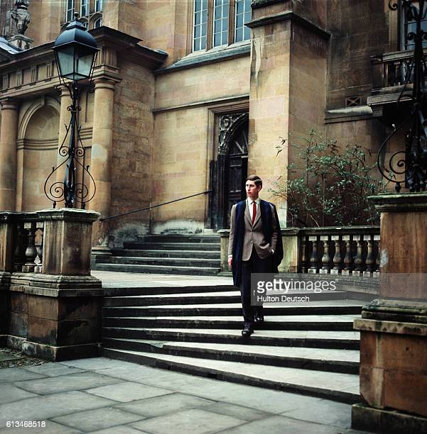 Prince Charles walking in his gown during his time as an undergraduate at Trinity College Cambridge | Location Cambridge Cambridgeshire England UK