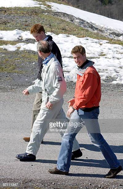 Prince Charles Walking With His Teenage Sons Prince William And Prince Harry At The Start Of Their Annual Skiing Holidays