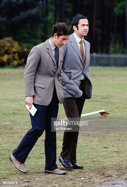 Prince Charles walks with King Constantine of Greece in Windsor Great Park. .