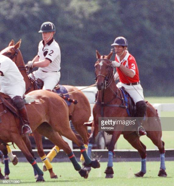 Prince Charles was locked in a fierce battle with Princess Diana's friend Major James Hewitt today on the polo field At one stage as Major Hewitt...