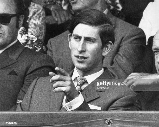 Prince Charles watching a match between Dennis Ralston and John Newcombe, on the Centre Court during the Wimbledon Lawn Tennis Championships, London,...