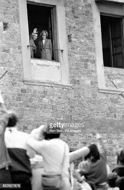 Prince Charles waves to the crowds as he and the Princess of Wales admire the view over Florence from a San Miniato church.