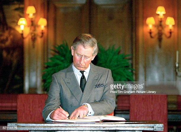 Prince Charles, Wearing A Black Tie For Mourning, Signs Condolences Book At The Spanish Embassy Following Bomb Outrage In Madrid