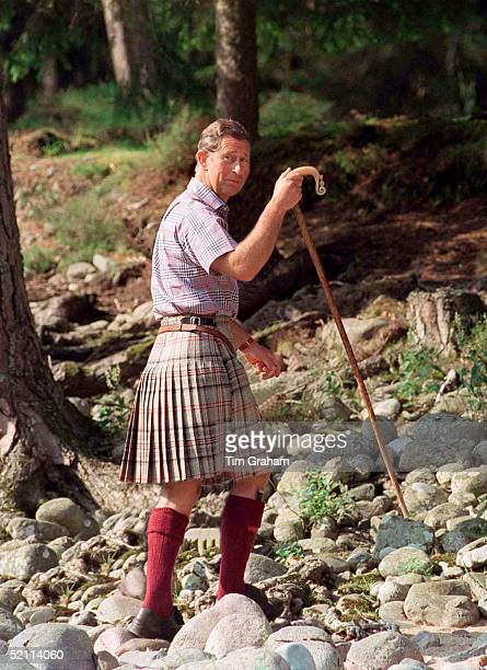 Prince Charles Wearing A Kilt And Carrying A Shepherd's Crook Walking Stick At Polvier Balmoral Castle Estate Wearing A Check Shirt Reported To Be By...