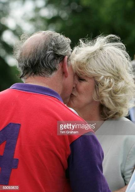 Prince Charles wins a prize and a kiss from his wife Camilla The Duchess of Cornwall after polo at Cirencester on June 17 2005 in Cirencester England