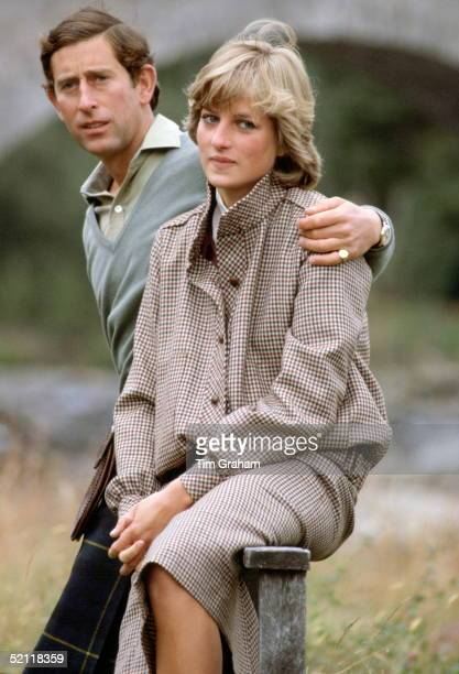 Prince Charles With His Arm Around Princess Diana As They Sit On A Style During Their Honeymoon At Balmoral In Scotland.the Princess Is Wearing A...