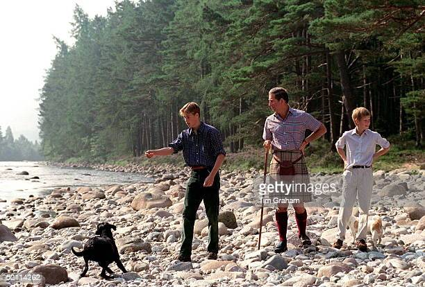 Prince Charles With Prince William Prince Harry At Polvier By The River Dee Balmoral Castle Estate Prince William Throwing Stones For His Black...