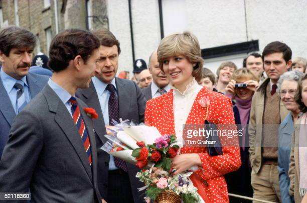 Prince Charles With Princess Diana In Their Local Town Of Tetbury Behind And Between Them Is The Princess's Bodyguard Graham Smithshe Is Wearing A...