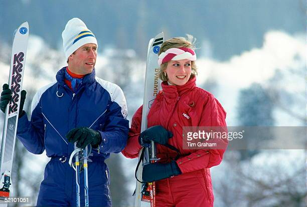 Prince Charles With Princess Diana On A Skiing Holiday Together The Princess Is Wearing A Red 'head' Ski Suit And A Headband And She Is Holding A...