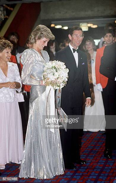 Prince Charles With Princess Diana Wearing A Silver Shimmering Lame Backless Dress Designed By Fashion Designer Bruce Oldfield They Are Attending The...