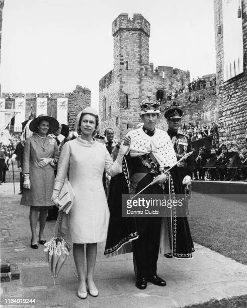 Prince Charles with Queen Elizabeth and Prince Philip, Duke of Edinburgh during the ceremony of Charles' Investment as Prince of Wales at Caernarfon...