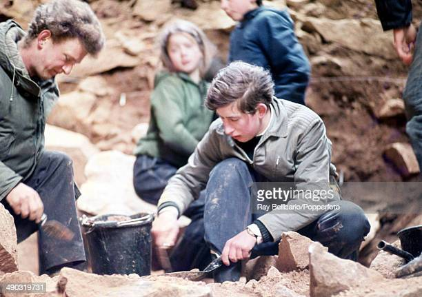 Prince Charles working on an archaeological dig at a Paleolithic site in a cave at La Cotte de St Brelade on the island of Jersey on 1st April 1968