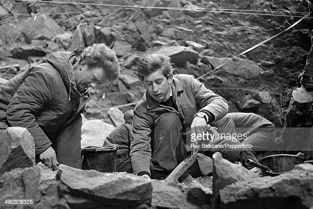 Prince Charles working on an archaeological dig at a Paleolithic site in a cave at La Cotte de Brelade on the island of Jersey 1st April 1968