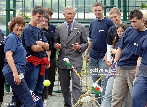 Prince Charles,Prince of Wales attempts a shot in a catapult game during a visit the Prince's Trust Cymru Activity Centre at Pembroke Dock on July 3,...