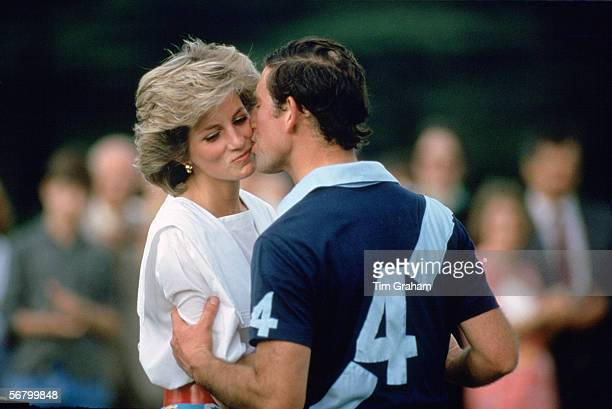 Prince Charles,The Prince of Wales kissing Princess Diana at prizegiving after a polo match at Cirencester.