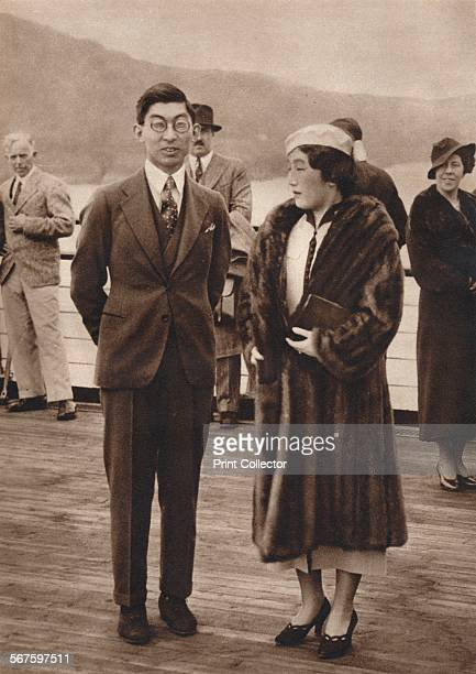 'Prince Chichibu and Princess Chichibu arriving on the Queen Mary, April 12th for King George VI's coronation'. Prince Chichibu was representing his...