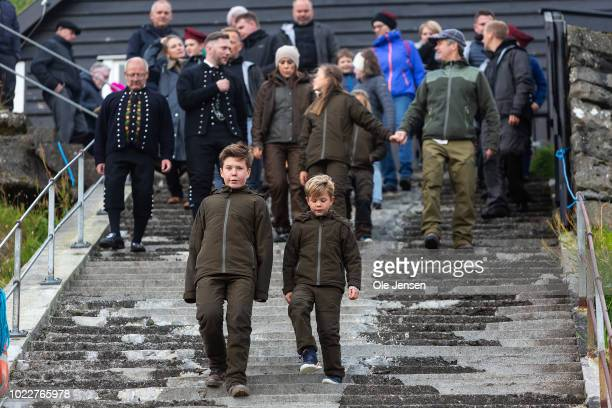 Prince Christian and Prince Vincent leads the Danish Royal Crown Prince family down the many stairs at the village of Mikladalur near Klaksvig to see...