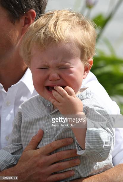 Prince Christian of Denmark cries during a photocall for the Royal Danish family at their summer residence of Grasten Slot on August 3, 2007 in...
