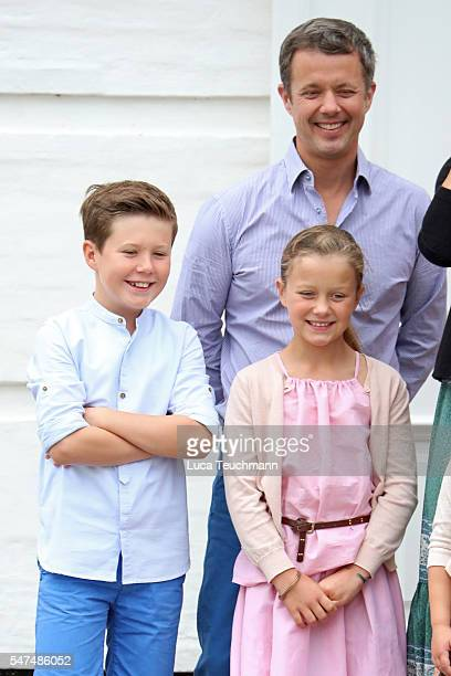 Prince Christian of Denmark Crown Prince Frederik of Denmark and Princess Isabella of Denmark pose for photographers at the annual summer photo call...