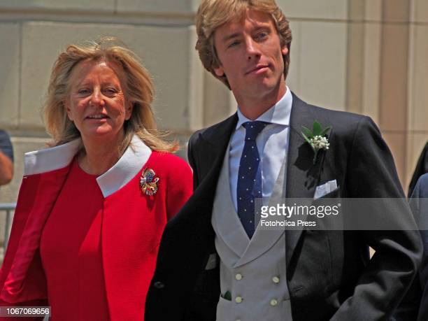 Prince Christian of Hannover walks accompanied by his mother Chantal Hochuli as they arrive for his wedding with Alessandra de Osma