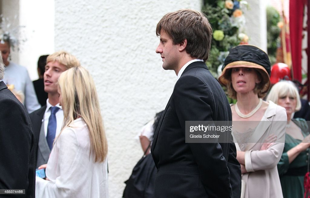 Prince Christian von Hannover (L) and his brother Ernst August von Hannover jr. attends the wedding of Maria Theresia Princess von Thurn und Taxis and Hugo Wilson at St. Joseph Church in Tutzing on September 13, 2014 in Tutzing, Germany.