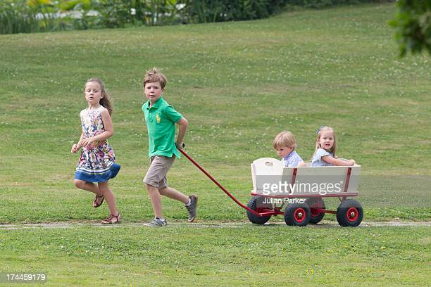 Prince Christian,and Princess Isabella of Denmark, pull their brother and sister Prince Vincent, and Princess Jospehine along, while attending the...