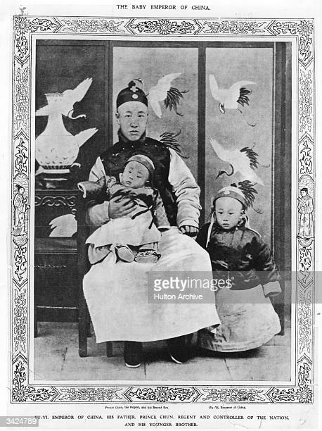 Prince Chun Regent and controller of the Nation with his younger son on his knee and PuYi Emperor of China by his side
