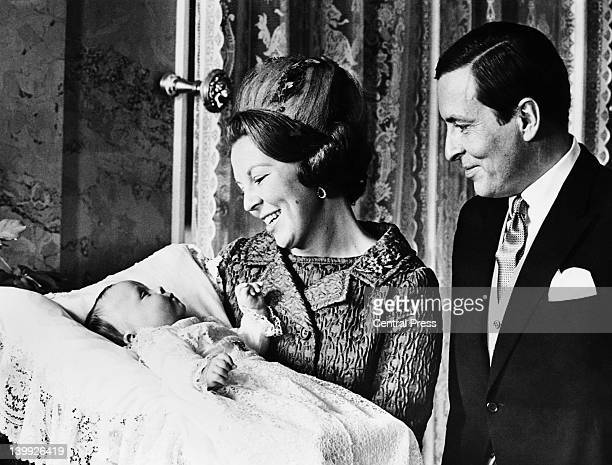 Prince Claus of the Netherlands and Princess Beatrix of the Netherlands with their second son, Prince Friso of Orange-Nassau, after his christening...