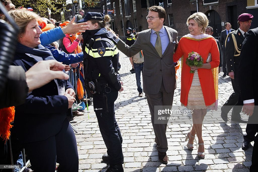 Prince Constantijn (C) and Princess Laurentien walk through in Dordrecht, on April 27, 2015, during King's Day (Koningsdag), the celebration of the birthday of the king. The Dutch King and Queen will visit the city for the national holiday.