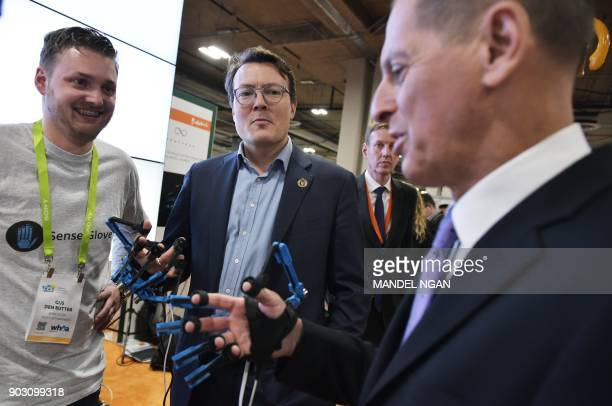 Prince Constantijn of the Netherlands and Consumer Technology Association President and CEO Gary Shapiro are fitted with virtual reality controller...
