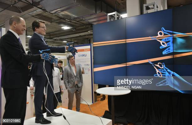 Prince Constantijn of the Netherlands and Consumer Technology Association President and CEO Gary Shapiro takes part in a ribbon cutting wearing...