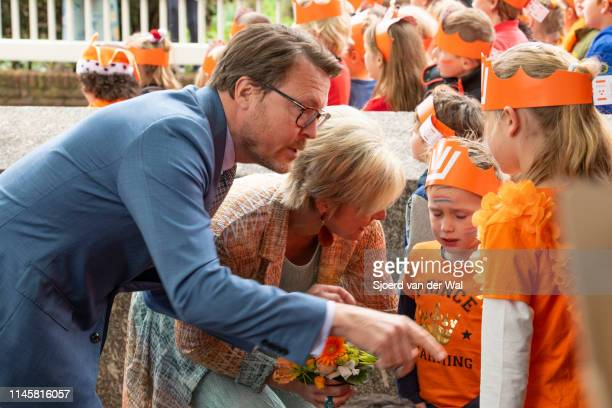 Prince Constantijn of the Netherlands and Princess Laurentien of the Netherlands comforting two small children during their visit to the city of...