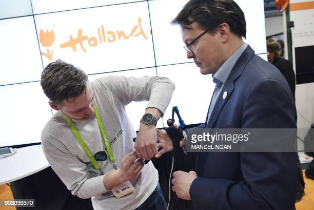 Prince Constantijn of the Netherlands is fitted with a virtual reality controller glove before the official opening of the Holland Startup Pavillion...