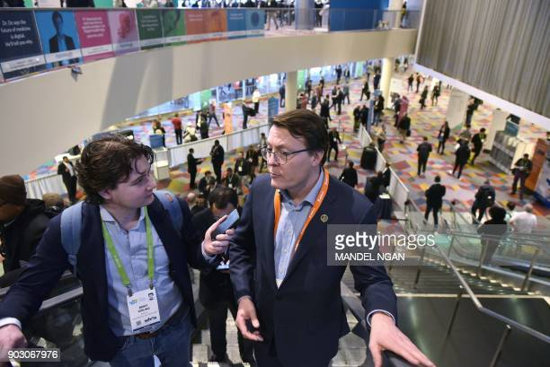 Prince Constantijn of the Netherlands rides an escalator in the Sands Convention Hall during CES 2018 in Las Vegas on January 9 2018 / AFP PHOTO /...