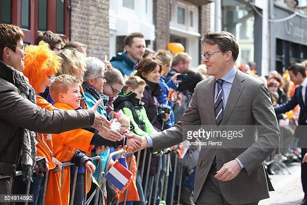 Prince Constantijn of The Netherlands shakes hands with supporters during King's Day the celebration of the birthday of the Dutch King on April 27...