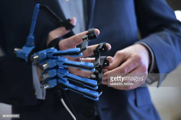Prince Constantijn of the Netherlands wears a virtual reality controller glove during the official opening of the Holland Startup Pavillion in the...