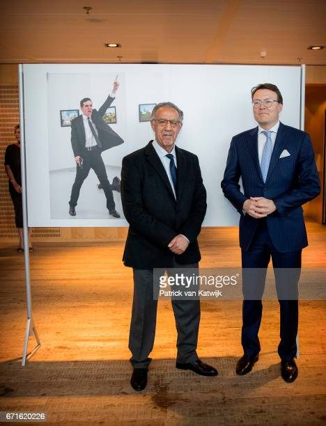Prince Constantijn of The Netherlands with Turkish AP photographer Burhan Ozbilici pose with the World Press Photo winning picture of the murder of...