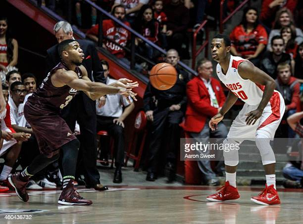 Prince Cooper of the LouisianaMonroe Warhawks passes to a teammate as Sam Logwood of the New Mexico Lobos defends during their game at The WisePies...
