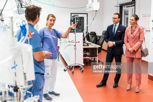Prince Daniel and Crown Princess Victoria of Sweden visit the ECMO Center at Karolinksa University Hospital and are given a tour by Mia Petterson and...