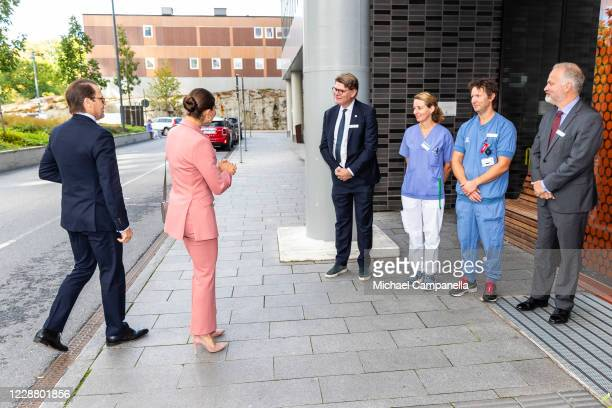 Prince Daniel and Crown Princess Victoria of Sweden visit the ECMO Center at Karolinksa University Hospital and are greeted by Mia Petterson and Lars...