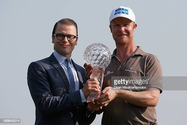 Prince Daniel Duke of Vastergotland the husband of Crown Princess Victoria of Sweden presents Mikko Ilonen of Finland the trophy after he wins the...