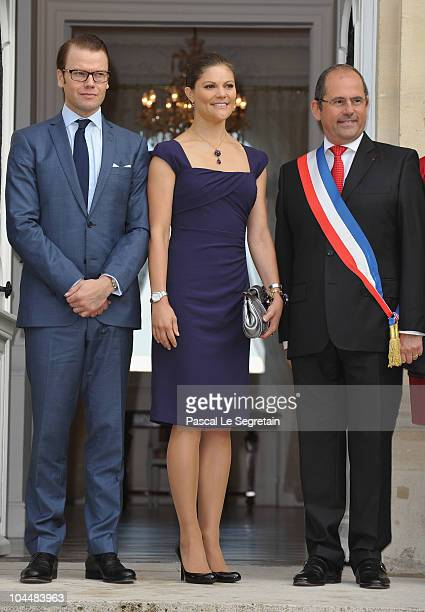 Prince Daniel of Sweden Crown Princess Victoria of Sweden and mayor Philippe Laurent pose as they arrive to attend a reception at Sceaux Town hall on...